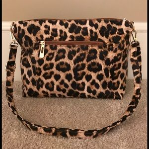 Adorable cheetah purse.  Very functional.